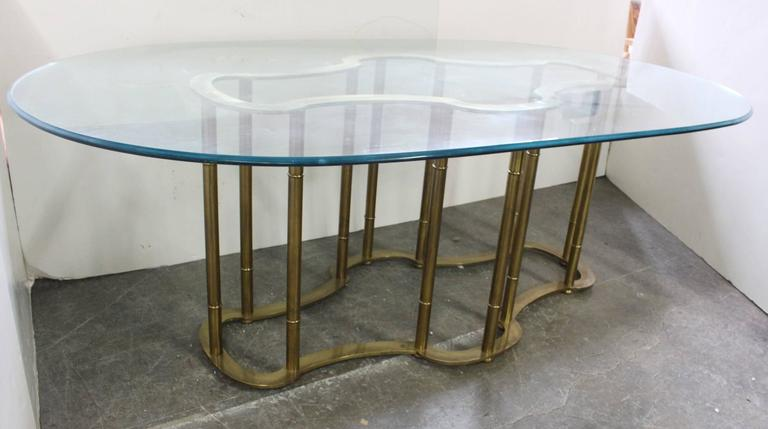 this oval glass brass dining table by mastercraft is no longer