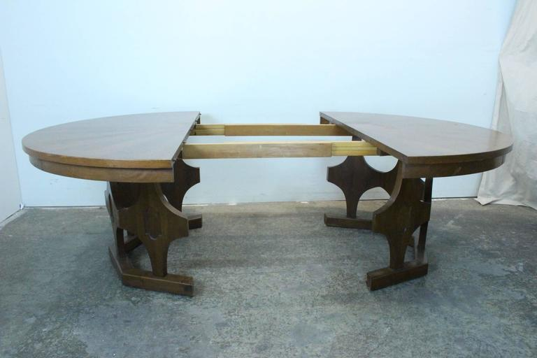 1960s Mid-Century Expandable Round Walnut Dining Table at 1stdibs