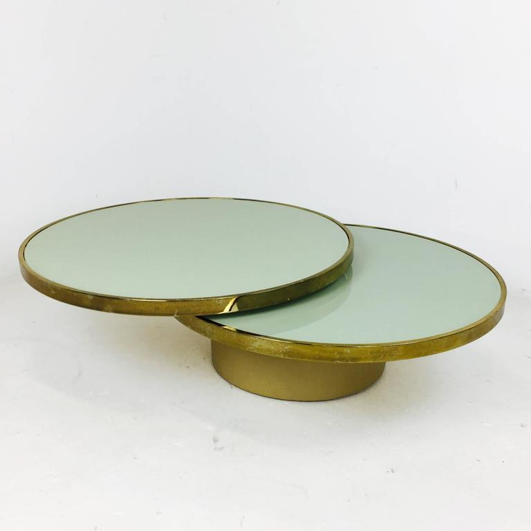 Swivel brass and glass coffee table by dia design for Cream glass coffee table