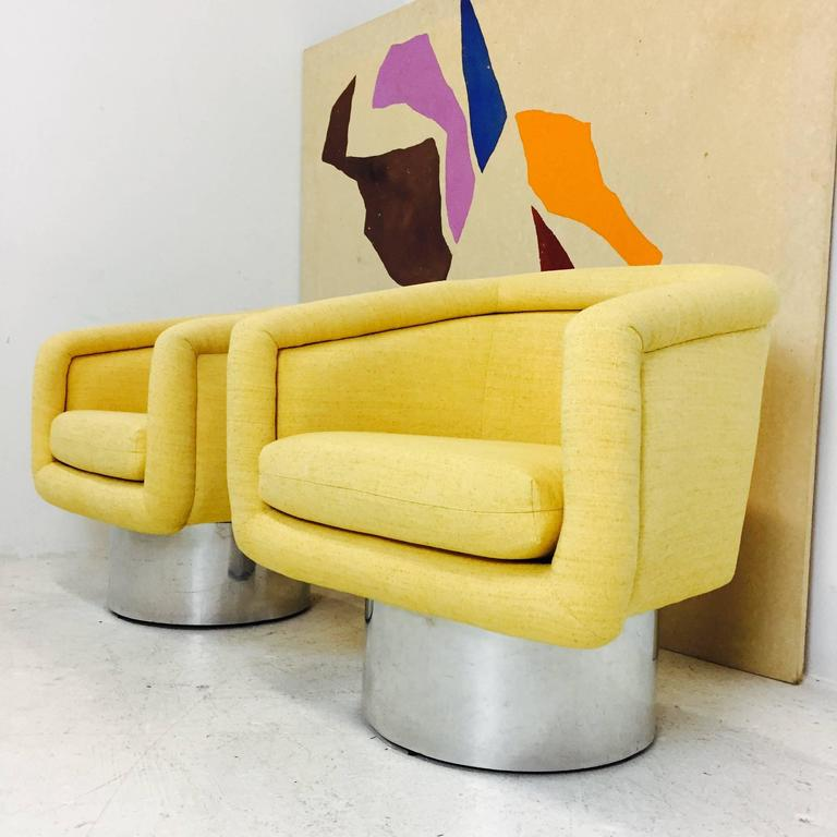 """Cheerful and elegant upholstered swivel chairs with plinth base designed by Leon Rosen for Pace collection. Upholstery is in good condition with minimal soiling, circa 1970s contact for more information on condition.  Dimensions: 29"""" W x"""