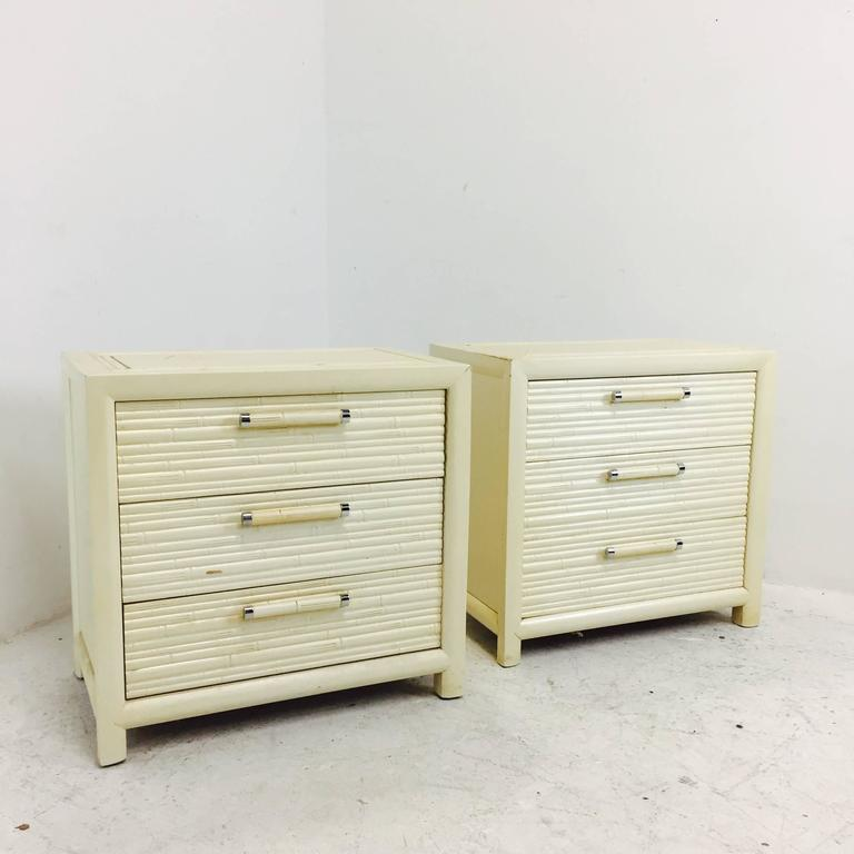 Pair of faux bamboo nightstands by Century. There is visible wear on the nightstands. New lacquer is all these guys need to be updated, circa 1960s.  dimensions: 26