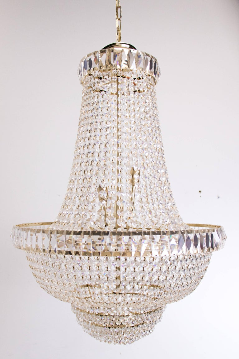 Nine-light crystal chandelier. The chandelier is in good vintage condition with signs of wear due to age.