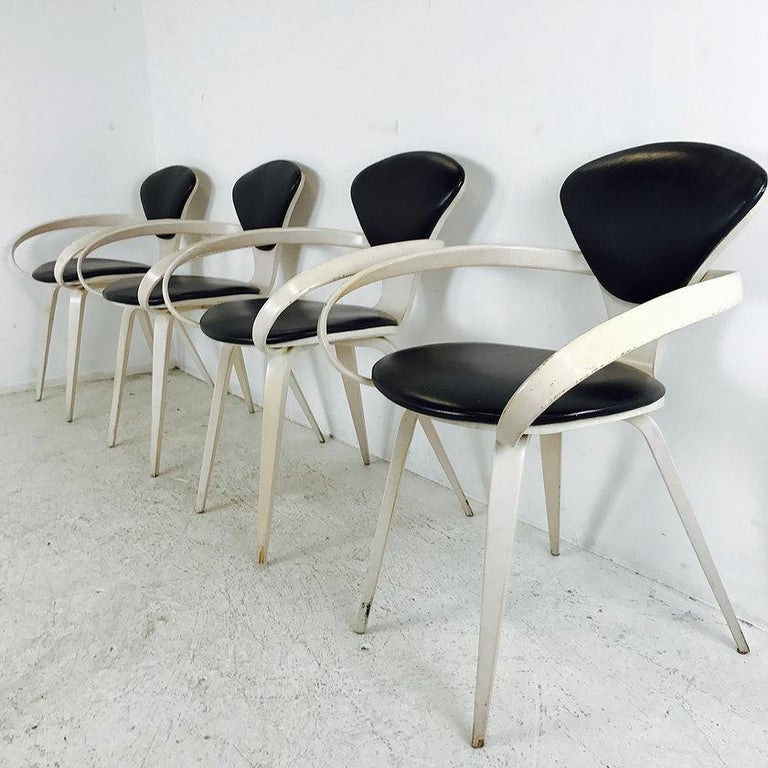 Set of four Cherner armchairs. Chairs are in good vintage condition and refinishing is recommended, circa 1960s.  Dimensions: 25