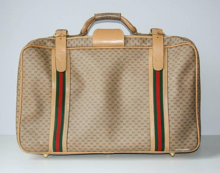 Gucci leather and fabric logo suitcase with brass insignia italy circa 1970 for sale at 1stdibs for Gucci car interior fabric for sale