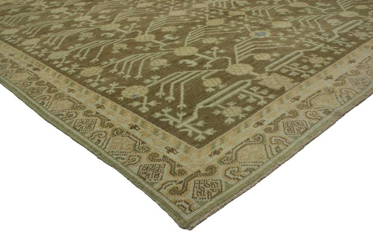 From casual elegance to fresh and formal, relish the refinement as this modern Turkish Oushak rug with transitional style and Khotan design evoke an air of warmth and comfort with its timeless aesthetic. Rendered in an earth-tone color palette of