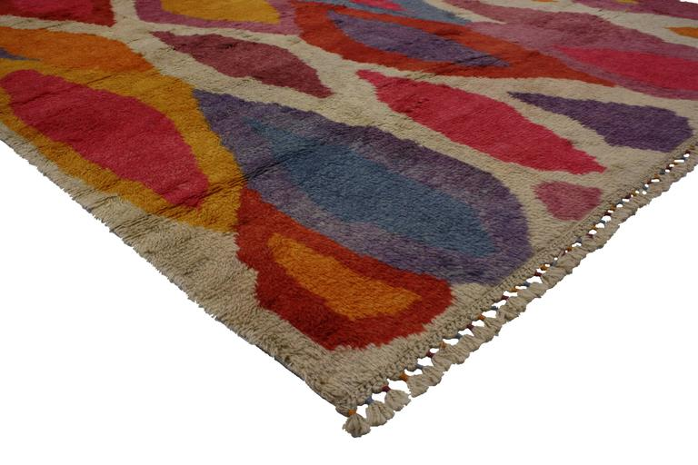 Set off with stylish levels of complexity and its highly decorative aesthetic, this Modern Turkish Tulu Shag rug features a contemporary abstract style in vibrant colors. The abstract designs in this Contemporary Turkish Tulu Shag rug synthesize