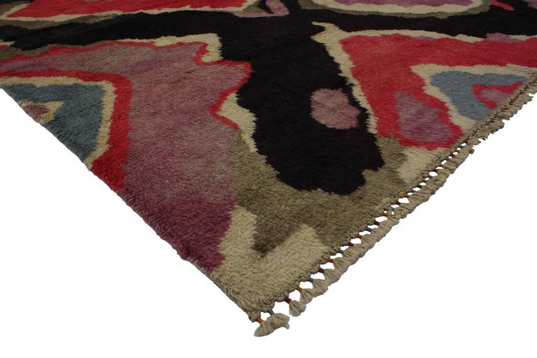 Add glamour to your home with a high-contrast color combination found in this modern Turkish Tulu shag rug with contemporary abstract style. Impeccably woven from angora wool in vibrant colors, this Turkish Tulu rug does an excellent job of