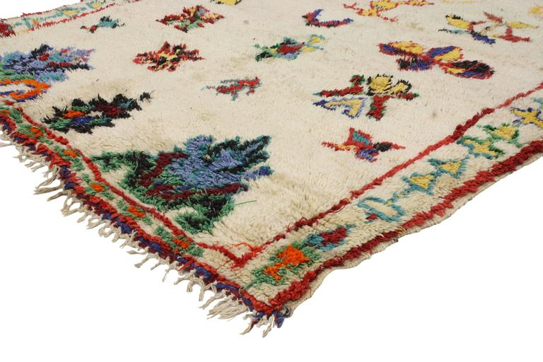 Get a rich and exotic look with this vintage Berber Moroccan rug. With its modern tribal design and Primitive charm, this Moroccan rug has all the warmth and presence of true Berber culture without overwhelming its surroundings. Featuring an