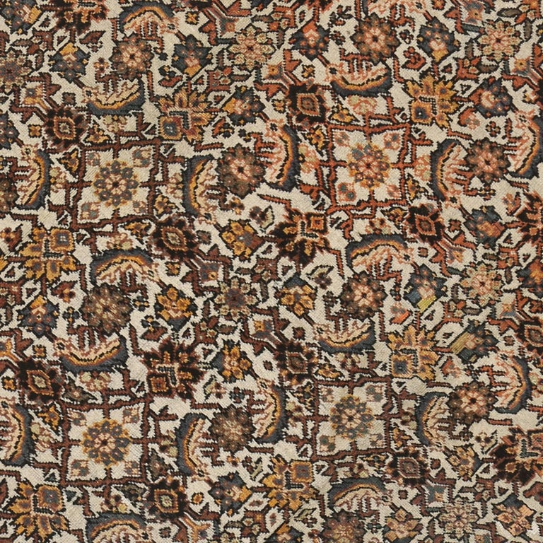 72504 Antique Persian Mahal Rug with Herati Pattern and Rustic Arts & Crafts Style. Sophisticated and full of character, this antique Persian Mahal rug combines traditional character with mid-century modern style. With its bold elemental nature and