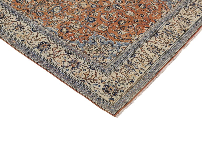 This orange and blue vintage Persian Mahal rug displays a highly sought-after color combination. Featuring an all-over geometric design on an abrashed orange field surrounded by a cream border and light blue spandrels. Rendered in a beautiful array