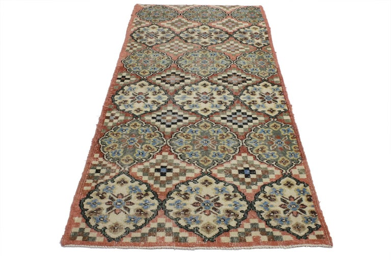 52013, distressed vintage Turkish Sivas accent rug in Swedish Farmhouse Style. This distressed Turkish Sivas rug features large alternating cusped medallions and stair-step amulets in rows of three in reverse color palettes. This vintage Turkish