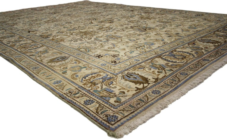 75518 Vintage Persian Tabriz rug with traditional style. This hand-knotted wool vintage Persian Tabriz rug features an all-over pattern surrounded by a classic border creating a well-balanced and timeless design. This vintage Persian Tabriz rug