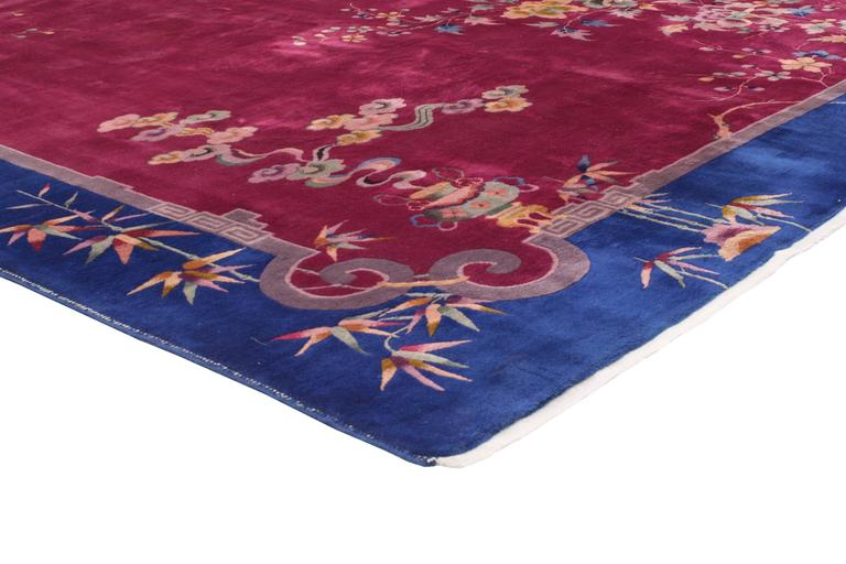 76766 Early 20th Century Antique Chinese Art Deco Rug Inspired by Walter Nichols 8'09 x 11'05. This hand knotted wool antique Chinese Art Deco rug features a color-blocked field and border scheme festooned with large, glorious sprays of flowers.