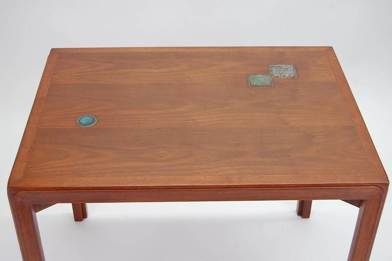 Occasional table in walnut with Natzler tiles, designed by Edward Wormley for Dunbar. From Dunbar's