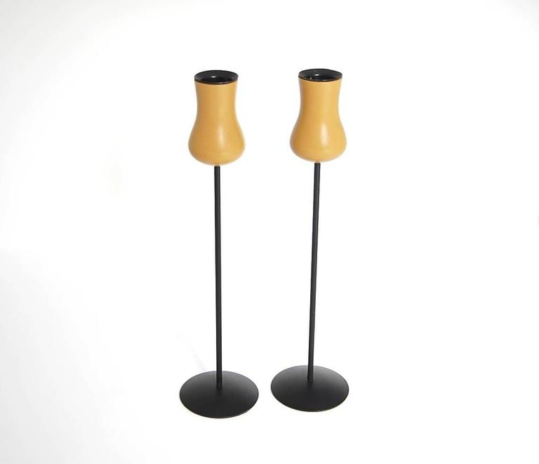 Pair of Torben Orskov candlesticks, circa 1968, Denmark. Steel and lacquered wood. Measure 11 1/4