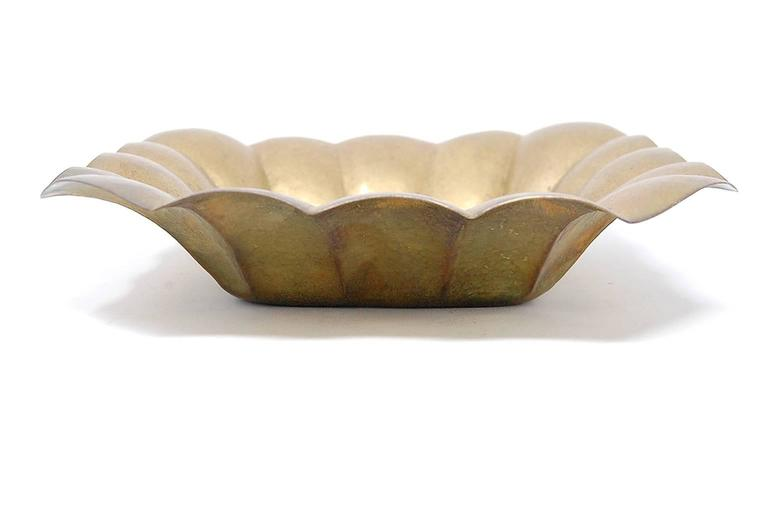 Rare brass low bowl by Albert Reimann   We offer free delivery on most of our items within the long Island or greater NYC, Northern New Jersey, and New England areas. Please inquire for further details. We also offer free professional packing and