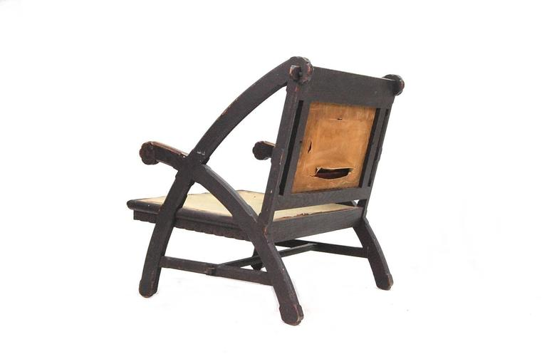 Exceedingly rare American Aesthetic Movement lounge chair designed by Architect Henry Hobson Richardson. This chair is based on the design that Richardson did for the Woburn, Massachusetts Public Library, circa 1876, and was most likely made by the
