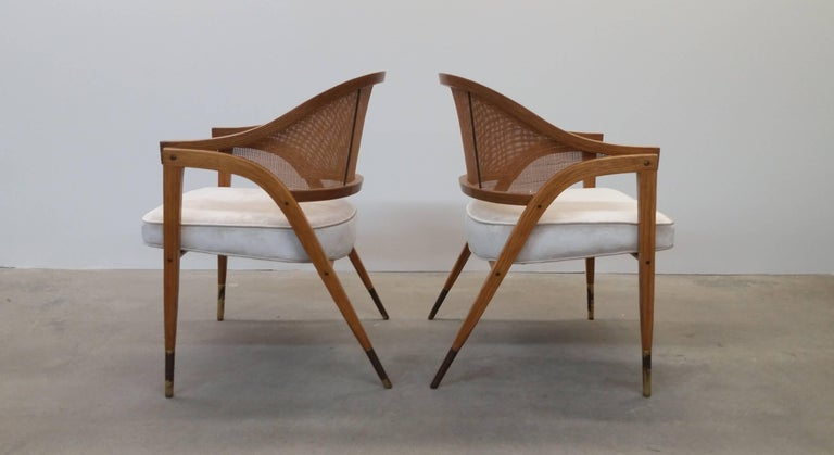 Pair of Dunbar model number 5480 chairs in ash and brass, circa 1962. Arguably one of Wormley's best designs. Newly upholstered in an off white cut velvet. New foam was installed during re-upholstery process. Brass sabots show patina/tarnish, but we
