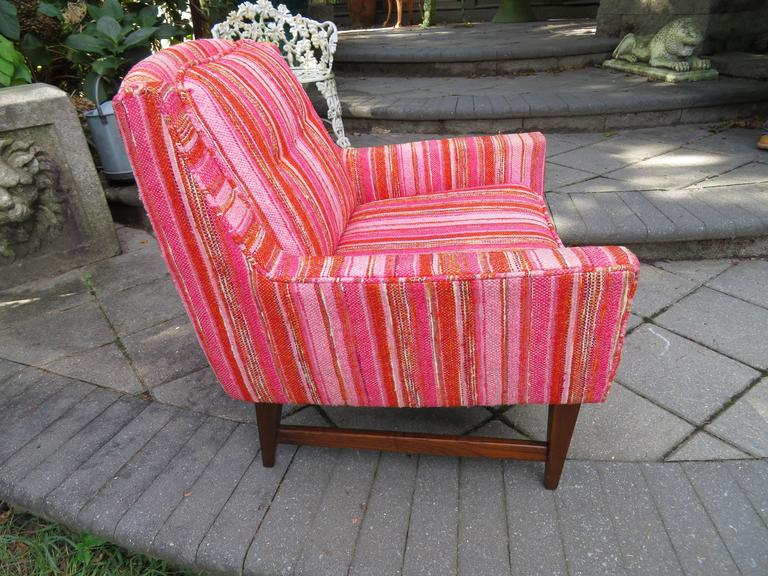 Lovely pair of Mid-Century Modern walnut lounge chairs by Selig. This pair retain their original pink and red striped nubby fabric in nice usable condition, we do recommend re-upholstery.