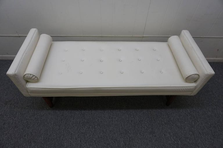 Handsome American Mid-Century Modern upholstered bench with lovely walnut base. We love the high sides with cylinder pillows and button tufted seat. Great piece used at the foot of the bed or in entry hall.