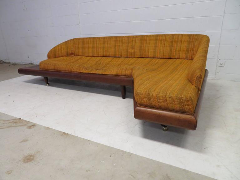 Very unusual Adrian Pearsall sculptural walnut boomerang sofa with attached side table. Of-course this will need to be re-upholstered but this is the perfect high style sofa to do! We love the small attached side table on one side and tiny finished