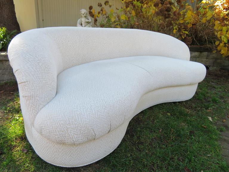 Excellent pair of Vladimir Kagan style kidney shaped sofas. This pair is super clean and in excellent condition.