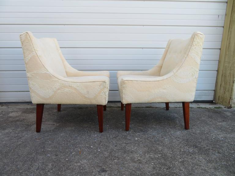 A nicely scaled pair of slipper chairs. Of course these will need to be re-upholstered but that's what you designers are looking for -right?