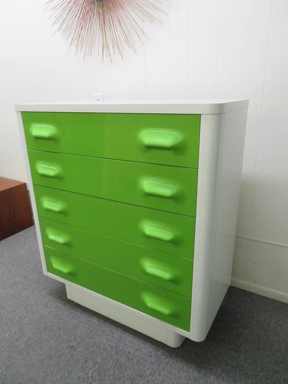 Space age injection molded plastic drawer fronts. White laminate top over lacquered case. In very good condition. Manufactured by Broyhill, well crafted design. You will love these colorful piece in the bedroom or any living space.
