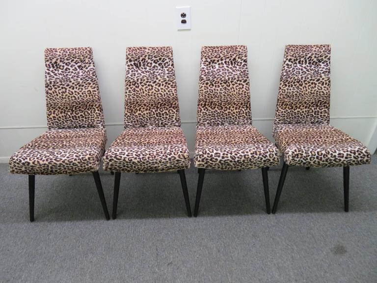 Stunning set of four Adrian Pearsall black lacquered dining chairs. These chairs retain their original black lacquered finish in very nice condition-very rare color. Also the white faux leopard is vintage and still looks great-very well cared for.