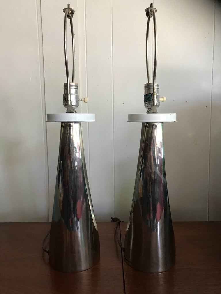 Gorgeous pair of chrome Laurel hairpin lamps. These lamps are on the smaller side measuring 23