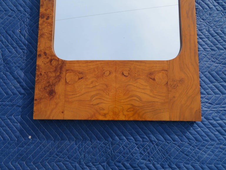 This gorgeous vintage modern mirror features a lovely burl olive wood frame. Sleek rectangular design with elegant wood grain throughout makes this wonderful mirror the perfect addition to any modern interior.