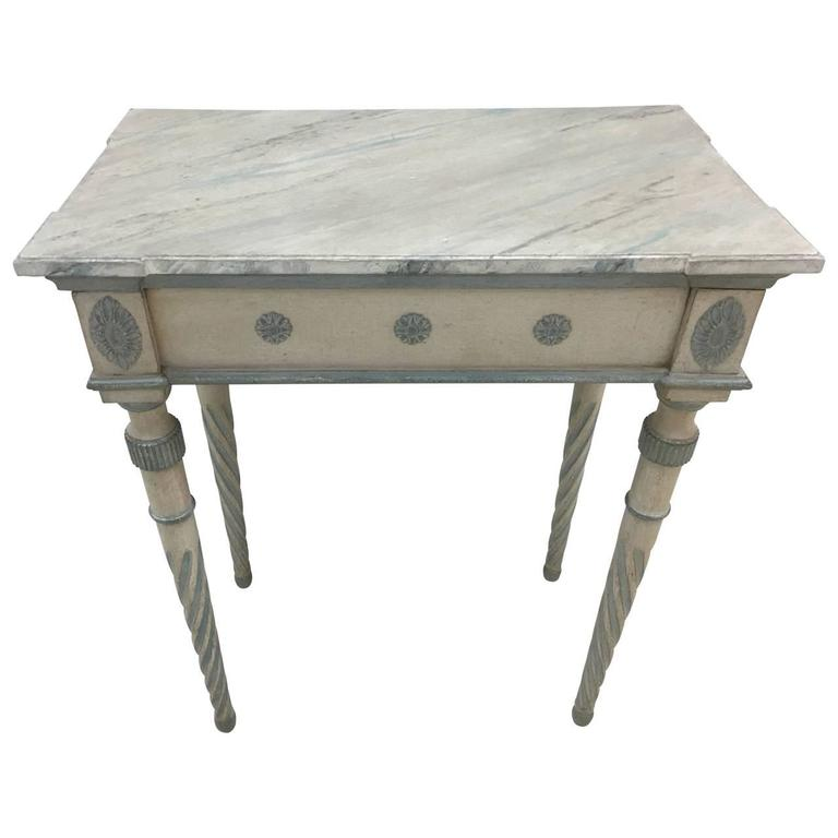 Grey and blue painted console with a faux marble wood top.
