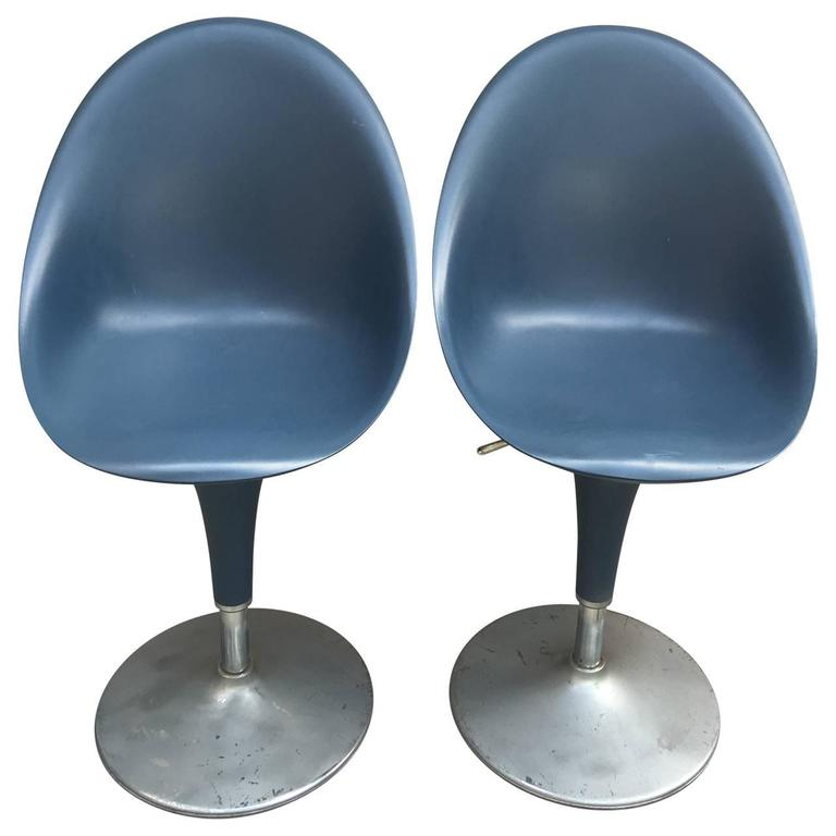 Two blue great looking Mid-Century chairs on aluminium base chairs. The seats adjusts up and down with the level handle under the seats.