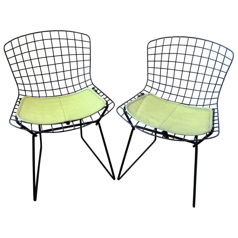 Pair of black metal Bertoia childs chairs with yellow the original Naugahyde pillows. This pair is smaller than most of the children's chairs available.  $125 flat rate front door delivery includes Washington DC metro, Baltimore and Philadelphia.
