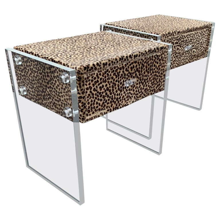 Pair of faux cheetah skin upholstered nightstands with Lucite side panels.