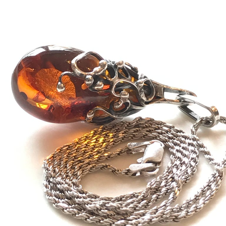 Amber pendant in a sterling silver setting with a Italian 925 silver chain.
