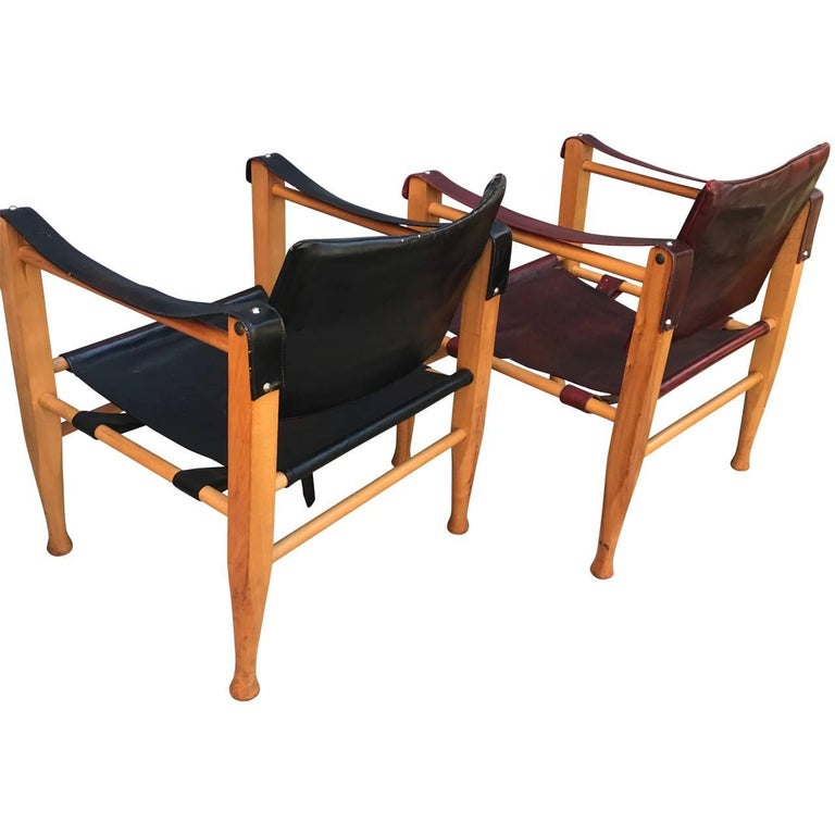 Set of Danish Two Mid-Century Modern Safari Chairs, One Red and One Black In Good Condition For Sale In Haddonfield, NJ