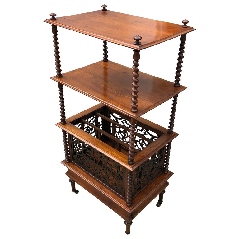 Mid-19th century English walnutètagerè and music stand  Antique music stand / Etagere shelf, circa 1855-1860, made from walnut. The top is decorated with wooden finials and has two beveled edge shelves held with barley twist stiles over a