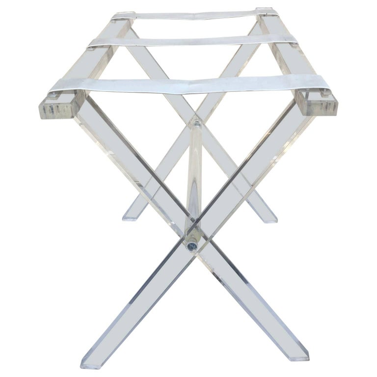 Vintage Hollywood Regency Lucite tray table or luggage rack, signed Scheibe.  Collapsed the stand measures H 24.5 by W 22.5 by D 3.75 inches.