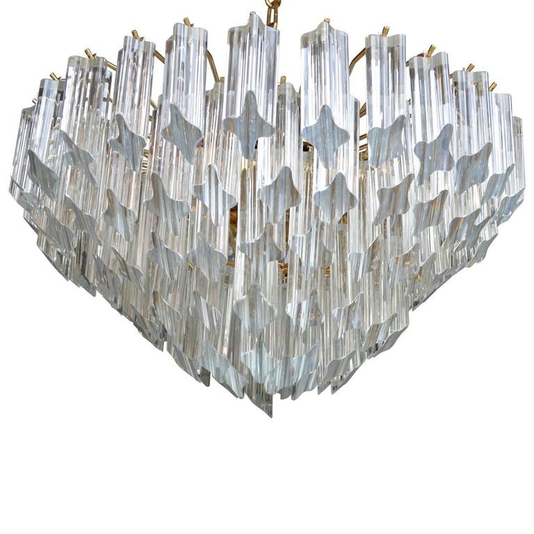 Stunning Venini multi-tiered prisms chandelier. Featuring six-tier Quatro Punta angle cut crystals. The frame is a brass plated steel with a 24