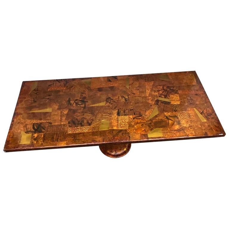 Large patchwork dining table on painted Industrial iron base. Glass top protects the art work. The tabletop is coated with thick hard lacquer that protect the great looking copper and brass patchwork.  Glass top is included but not pictured in this