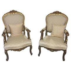 Pair of French Louis XV Style Giltwood Amrchairs