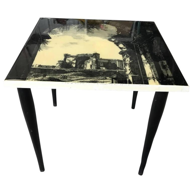 Cute Italian Mid-Century Modern end table with laminated lithographed scene of a Classic rural Italian country side. All legs are detachable and bottom part of the legs are has wear to the black paint.