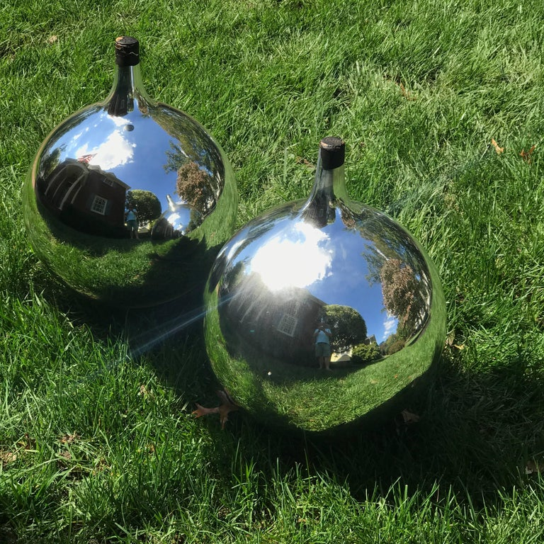 Large pair of decorative mercury glass balls for sale at