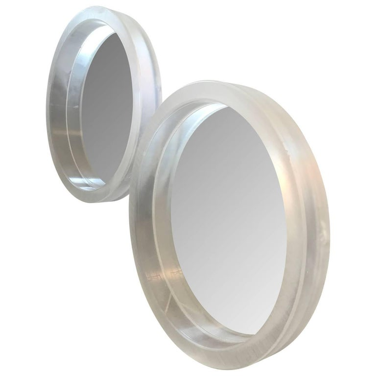 Stunning set of thick framed acrylic or Lucite mirrors. The surface on the mirrors are rough and individual, due the original cut. The mirrors can be lit from behind in white or a combination of colors. Please see detailed images. Measure: The depth