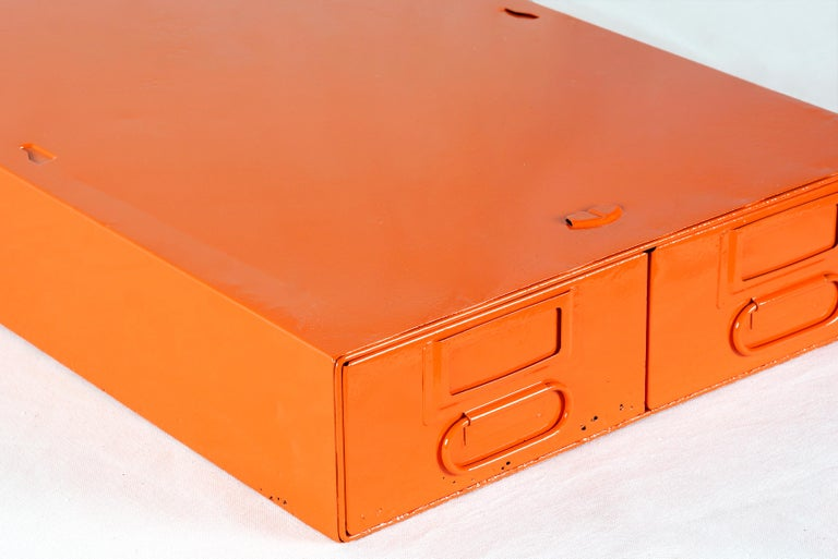 1940s card catalog filing unit with two deep, side by side pull-out drawers. Newly refinished steel in gloss tangerine powder coat (OG05). This heavy-duty organizational unit is perfect for storing anything from office supplies to recipe cards.