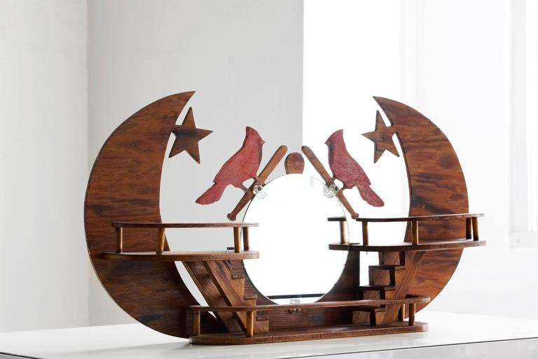 """Unique handmade wooden wall-sculpture/ display piece with mirror celebrating the St. Louis Cardinals. Fine example of American Folk Art; excellent craftsmanship.   Dimensions: 28"""" w 4"""" d x 14"""" h"""