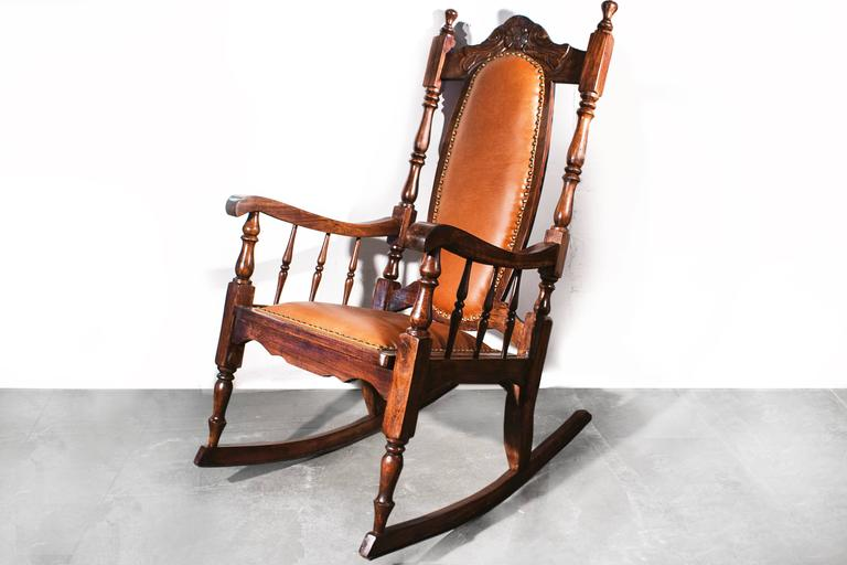 Antique oak rocking chair with hand-carved frame and spindle arms. Original  caning has - Victorian Era Oak Rocking Chair With Leather, 1890s At 1stdibs