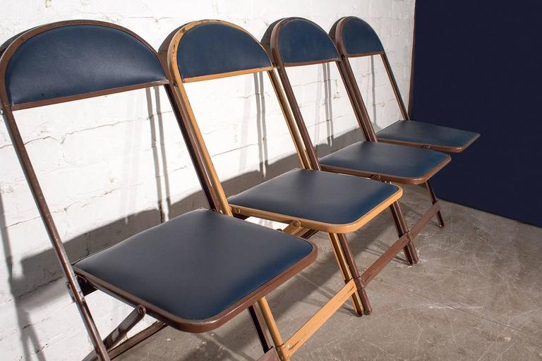 Retro Set Of Metal Folding Chairs Newly Refinished In High Quality Navy  Blue Vinyl.