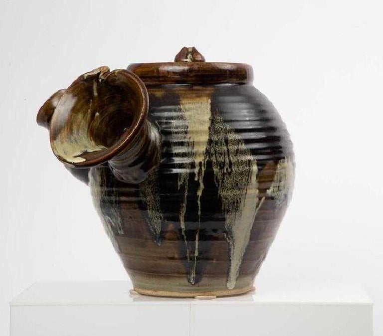 A oversized pottery art piece in the form of the single-handle tea pot (called Yokode Kyusu in Japanese), serves as a viewing sculpture rather than a practical utensil Created in the style of Tokoname ware with a brown glaze splashed and dripped
